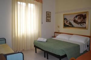 Letto o letti in una camera di Hotel Parco Fellini