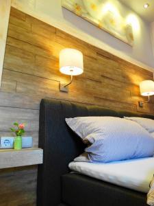 Ein Bett oder Betten in einem Zimmer der Unterkunft Ferienhaus Villa Rosi