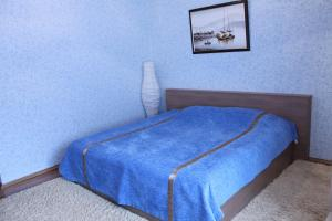 A bed or beds in a room at Rostov.ru