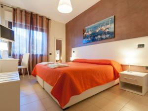 A bed or beds in a room at Al Molì Affittacamere