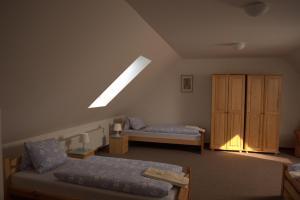 Posteľ alebo postele v izbe v ubytovaní Hostinec Škulec - Ubytovanie