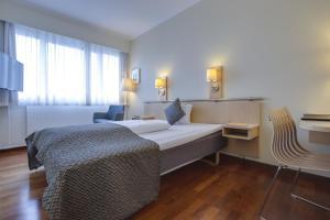 En eller flere senge i et værelse på Best Western Plus Airport Hotel