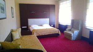 A bed or beds in a room at Maxim Pasha Hotel