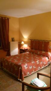 Un ou plusieurs lits dans un hébergement de l'établissement Chambre Hote Jacoulot