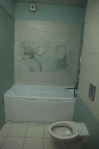 Ванная комната в Апартаменты на Клубничной
