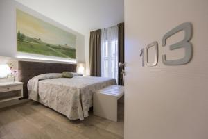 Кровать или кровати в номере Hotel Diamante