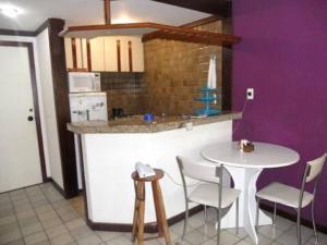 A kitchen or kitchenette at Píer Sul Apart Hotel - Circuito do carnaval