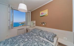 A bed or beds in a room at Villa Narona