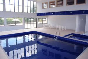 The swimming pool at or close to Sky Samuara Hotel Caxias do Sul