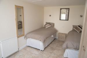 A bed or beds in a room at The Bell P.H.