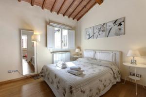 Cama o camas de una habitación en Residenza Novella & Giotto - Visitaflorencia