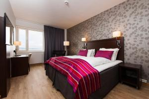 En eller flere senger på et rom på Victoria Hotel Hamar