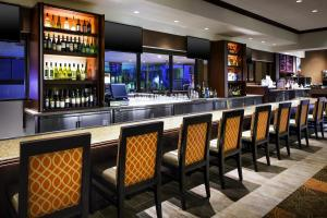 The lounge or bar area at Sheraton Suites Orlando Airport Hotel