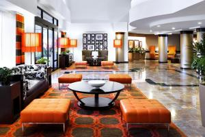 The lobby or reception area at Sheraton Suites Orlando Airport Hotel