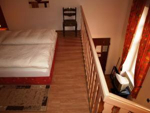 מיטה או מיטות בחדר ב-Hotel Liechtenstein Apartments II