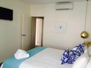 A bed or beds in a room at Rambutan Resort