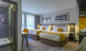 A bed or beds in a room at Maldron Hotel Pearse Street