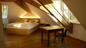A bed or beds in a room at Hotel Burgmeier
