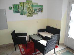 Ein Sitzbereich in der Unterkunft Pension Haus Nova