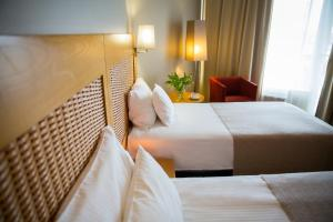 A bed or beds in a room at Georg Ots Spa Hotel