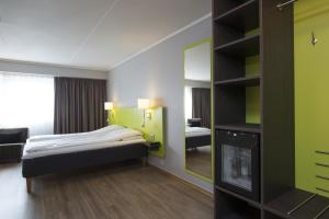 A bed or beds in a room at Thon Hotel Hallingdal
