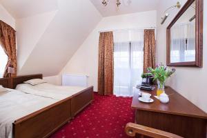 Łóżko lub łóżka w pokoju w obiekcie Pokoje Szlacheckie Gniazdo