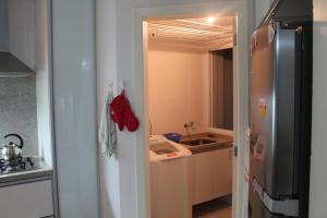A cozinha ou cozinha compacta de Via Vecchia Jurerê Internacional