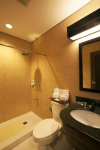 A bathroom at Microtel by Wyndham Boracay