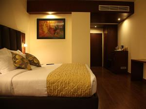 A bed or beds in a room at Hotel Cama