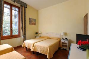 Кровать или кровати в номере Hotel Bologna