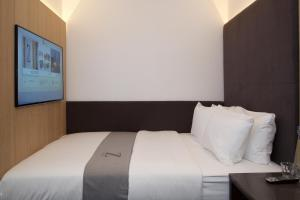 A bed or beds in a room at The Z Hotel Shoreditch