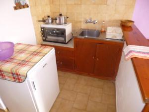 Kjøkken eller kjøkkenkrok på Irini Studios