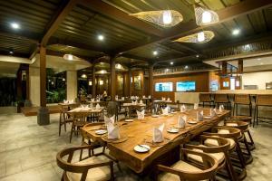 مطعم أو مكان آخر لتناول الطعام في فندق أنومانا أوبود