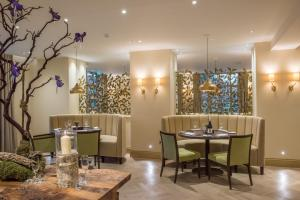 A restaurant or other place to eat at Careys Manor Hotel & Spa