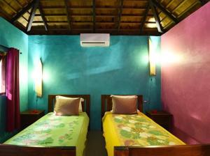 Cama ou camas em um quarto em Villa Mitirapa