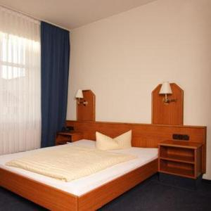 Кровать или кровати в номере Akzent Hotel Residence Bautzen
