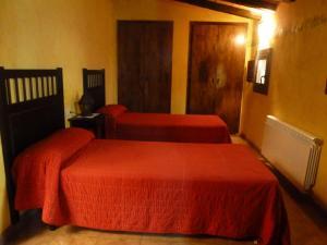 Llit o llits en una habitació de Masía Puigadoll