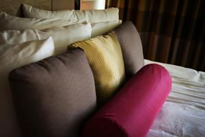 A bed or beds in a room at The Birchwood