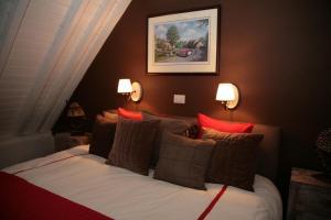 Een bed of bedden in een kamer bij B&B 't Verloren Schaap