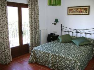 A bed or beds in a room at Casa Rural Mi Abuela Maria