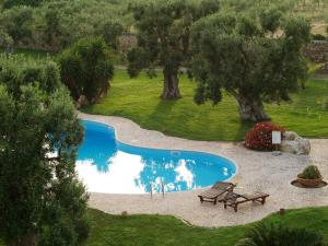 A view of the pool at Hotel Masseria Tutosa or nearby