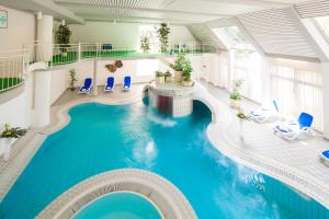 The swimming pool at or near Hotel Der Achtermann