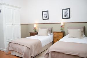 A bed or beds in a room at La Casona de Nazaret