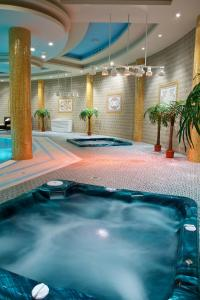 The swimming pool at or near Royal Tulip Almaty Hotel