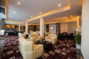 O lounge ou bar de Raoum Inn Buraydah