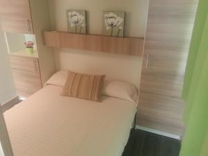 A bed or beds in a room at Camping Covadonga