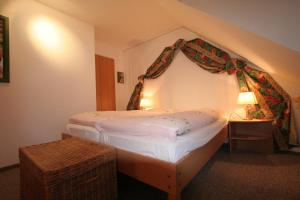 Кровать или кровати в номере Glaeßer Appartements