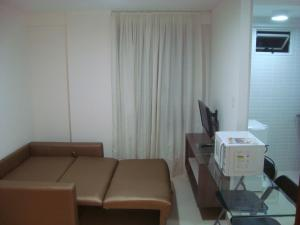 A seating area at Apartment Cabo Branco #4
