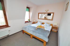 Łóżko lub łóżka w pokoju w obiekcie Aparthotel Mikołajki