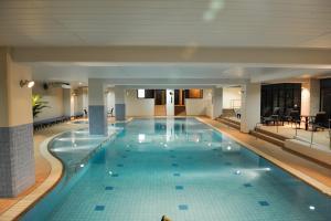 The swimming pool at or near GRANDVRIORESORT ISHIGAKIJIMA Ocean's Wing & Villa Garden